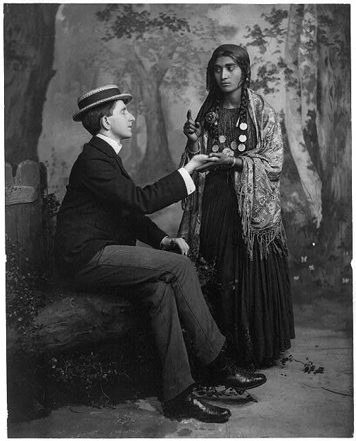 Man getting palm reading from a gypsy psychic